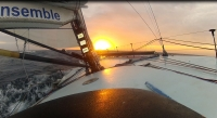Sailing VOR60 across the North Atlantic sunset