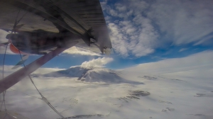 Twin Otter flying to Mt. Sidley
